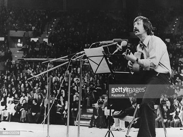 German singersongwriter Wolf Biermann in concert in the Olympic basketball hall in Munich Germany November 1976 He had recently been stripped of his...