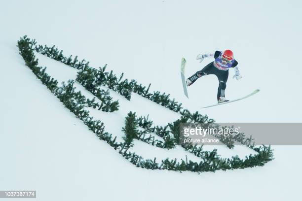 German ski jumper Markus Eisenbichler in action during his jump in the finale at the New Year's jump at the Four Hills Tournament in Nordic...