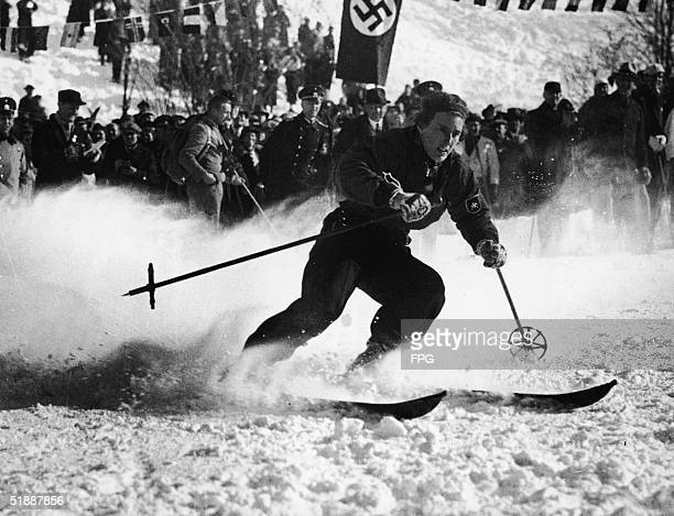 German skier Chistl Cranz competes before a crowd which includes uniformed Nazis in the women's alpine combined skiing event during the IV Winter...
