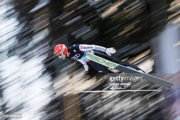 German skier Markus Eisenbichler in midair at the 65th Four Hills Tournament for skijumping and Nordic skiing in Bischofshofen Austria 06 January...