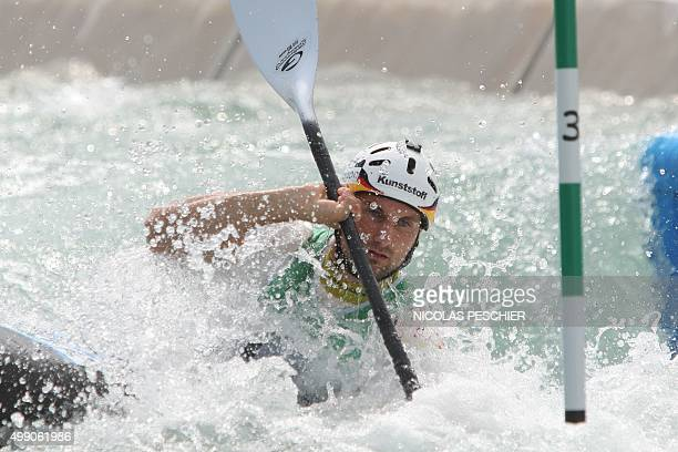 German slalom canoeist Alexander Grimm takes part in a test event for the Rio 2016 Olympic Games at the Deodoro Radical Park in Rio de Janeiro on...