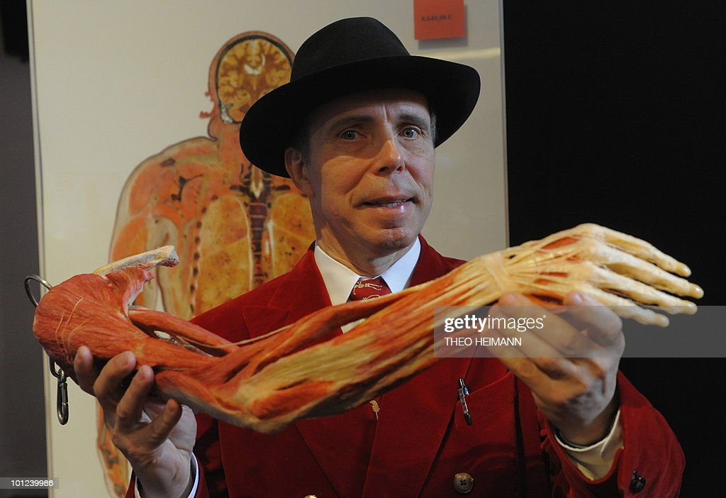 German so-called plastinator Gunther von Hagens poses with a preparated human arm at his 'Plastinarium' workplace in Guben, eastern Germany, on May 27, 2010. After years of creating controversy with his 'plasticised' dead bodies, a publicity-hungry German anatomist dubbed 'Doctor Death' went one step further, offering body parts for sale.