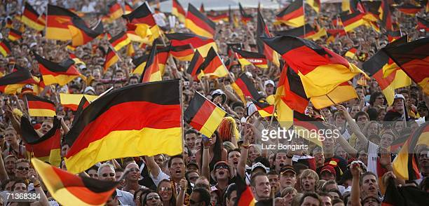 German soccer fans crowd the Fan Fest outdoor viewing area at the Heiligengeistfeld on July 4 2006 in Hamburg Germany The fans watch the FIFA World...