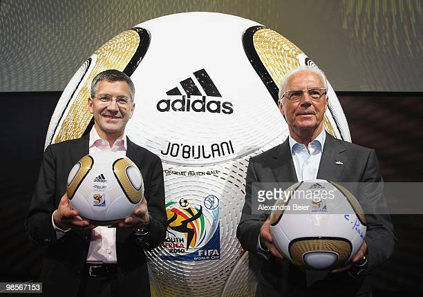 German soccer legend Franz Beckenbauer and Adidas CEO Herbert Hainer pose in front of a huge soccer ball during the presentation of the FIFA World...