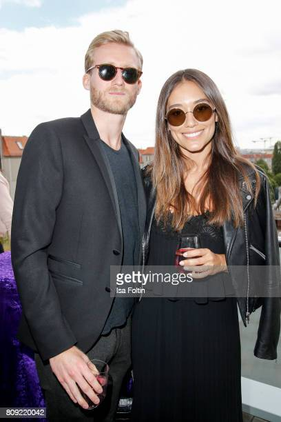 German soccer player Andre Schuerrle and his girlfriend model Anna Sharypova attend the Thomas Sabo Press Cocktail during the MercedesBenz Fashion...