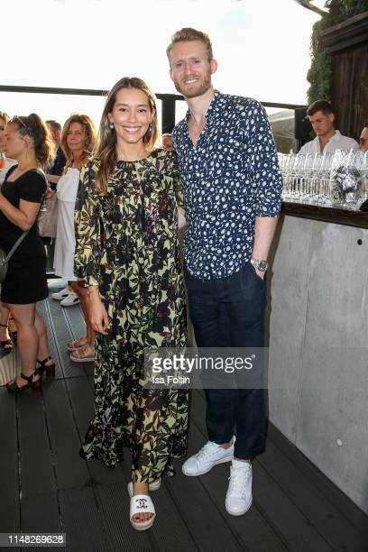 German soccer player Andre Schuerrle and his wife Anna Sharypova attend the GRACE Restaurant & Bar rooftop opening at Hotel Zoo on June 5, 2019 in...