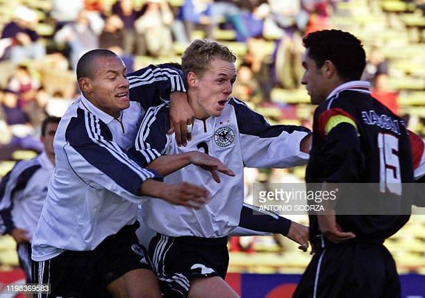 German soccer player Christoph Preuss celebrates a goal with teammate Jermaine Jones as Iraqi Atea Hassan looks on during the World Youth Football...