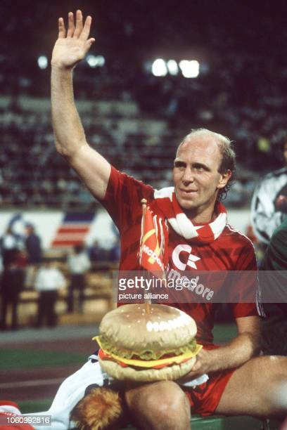 German soccer player Dieter Hoeneß waves to his fans after his last goodbye match in Munich on the 23rd of July in 1987
