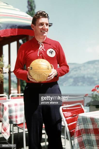German soccer player Fritz Walter wears a sweat suit and holds a soccer ball in his hands Germany 1954 The famous sports idol played for the 1st FC...