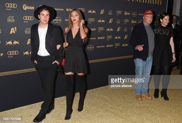 German soccer player Mario Goetze and his girlfriend model AnnKathrin Broemmel and the Formuka 1 legend Niki Lauda and his wife Birgit at the Kitz...