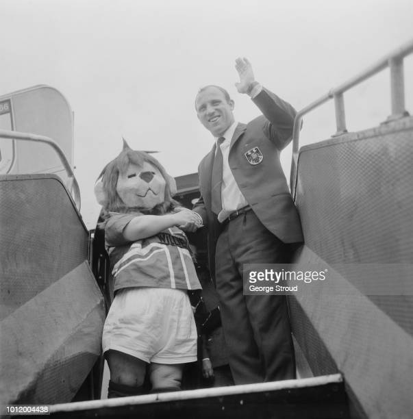 German soccer player Uwe Seeler of West Germany with a lion mascot embarking a flight to fly home after the 1966 Fifa World Cup UK 1st August 1966