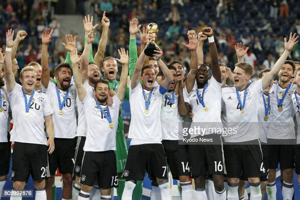 German soccer players celebrate after defeating Chile 10 in the Confederations Cup final in St Petersburg on July 2 2017 ==Kyodo
