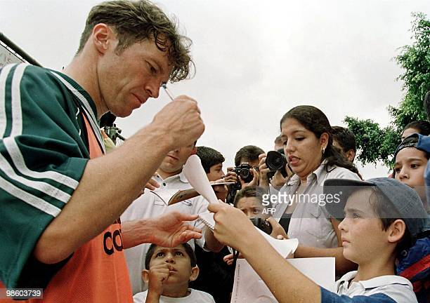 German soccer star Lothar Matthaus signs autographs for Mexican fans 22 July Guadalajara Mexico after a training session by the German team which...