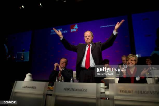 German Social Democrat and candidate for Chancellor Peer Steinbrueck waves to the guests as he attends the state convention of the SPD Lower Saxony...