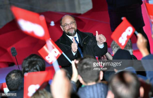 German Social Democrat and chancellor candidate Martin Schulz gives a thumbs up to the audience during an election campaign stop on September 14,...