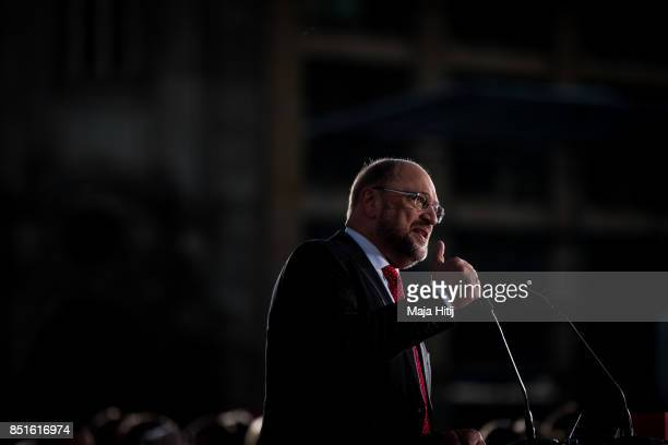 German Social Democrat and chancellor candidate Martin Schulz speaks to visitors at an election rally on Gendarmenmarkt square two days before Germa...