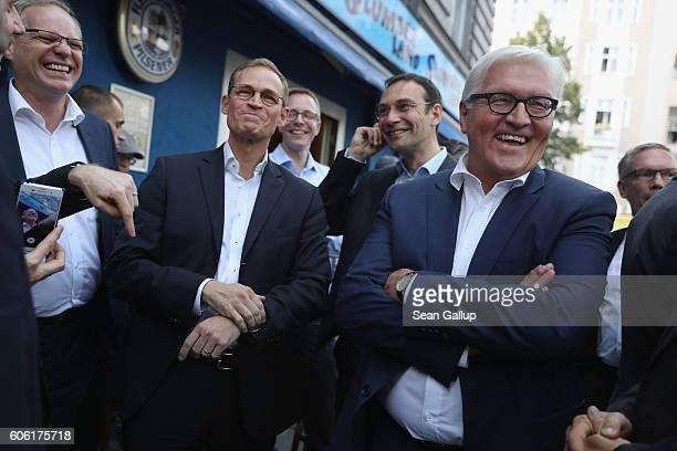 German Social Democrat and current Berlin Mayor Michael Mueller and Foreign Minister FrankWalter Steinmeier walk at Winterfeldtplatz before attending...