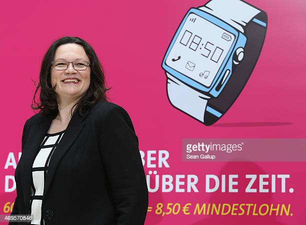 German Social Democrat and Minister of Work and Social Issues Andrea Nahles speaks to the media in front of posters promoting Germany's minimum wage...