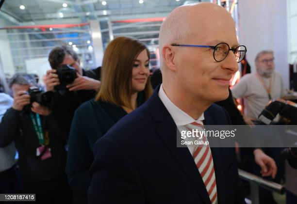 German Social Democrat incumbent Peter Tschentscher and German Greens party seond incumbent candidate Katharina Fegebank arrive to appear on ZDF...