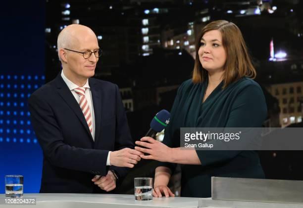 German Social Democrat incumbent Peter Tschentscher and German Greens party incumbent candidate Katharina Fegebank prepare to speak on ZDF television...