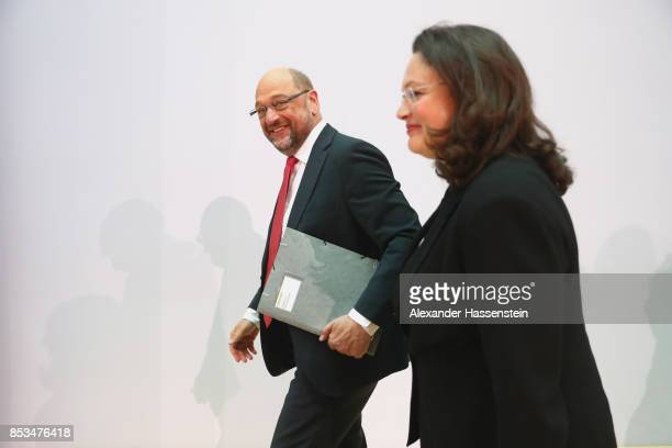German Social Democrat Martin Schulz who had run for chancellor in yesterday's federal elections arrives with Minister of Work and Social Issues...