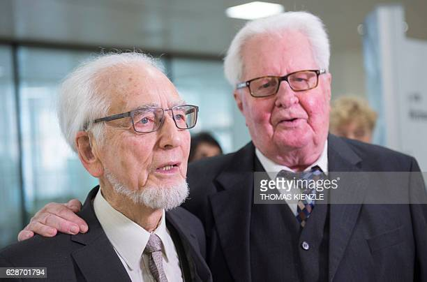 German social democrat politician Erhard Eppler is congratulated by former chairman of the German Social Democratic Party HansJochen Vogel during a...