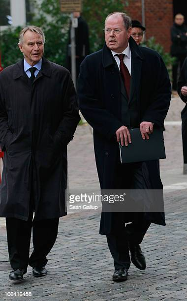 German Social Democrat politicians Peer Steinbrueck and HansUlrich Klose arrive for the memorial service for Loki Schmidt wife of former German...
