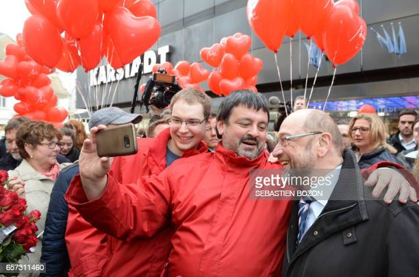 German Social Democratic Party candidate for Chancellery Martin Schulz poses for a selfie as he joined SPD top candidate in Saarland's upcoming...