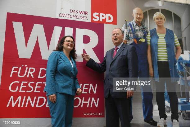 German Social Democrats candidate for chancellor Peer Steinbrueck and SPD General Secretary Andrea Nahles stand in front of SPD election campaign...