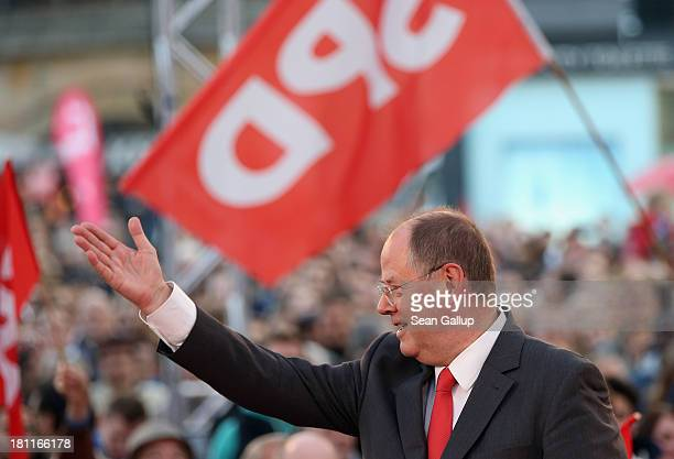 German Social Democrats chancellor candidate Peer Steinbrueck greets supporters upon his arrival at an SPD election rally on September 16 2013 in...