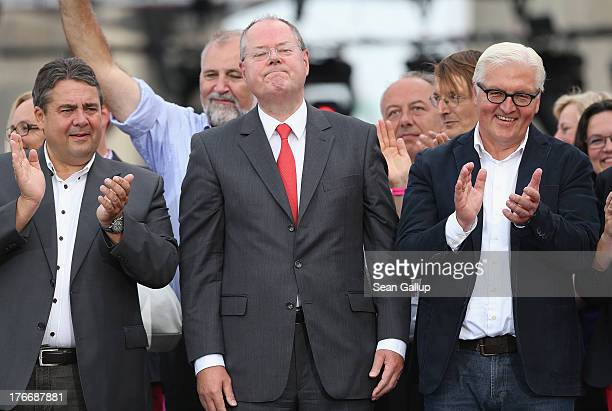 German Social Democrats chancellor candidate Peer Steinbrueck stands on stage with SPD Chairman Sigmar Gabriel and SPD Bundestag faction leader...