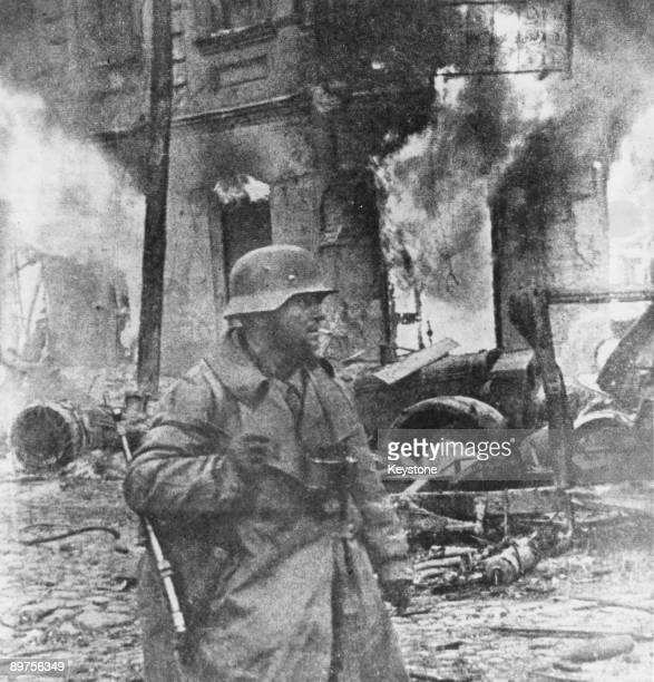 A German soldier amid the ruins of a town near Kiev Ukraine December 1943