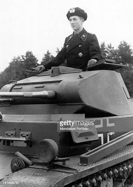 A German soldier coming out the cupola of his tank during training in the area of Wunstorf Hannover October 1939