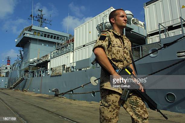 German soldier guards the German military supply ship Elbe at the port February 21, 2003 in Djibouti Town, Djibouti. The German Navy has several...