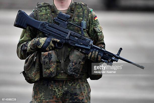 German soldier holds a machine gun MG4 during the 'Land Operations' military exercises during a media day at the Bundeswehr training grounds on...