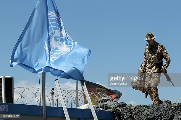 German soldier participating in the UNIFIL peacekeeping mission patrols the perimeter of a UN German Navy compund during the visit of German Defense...