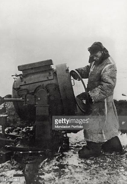 A German soldier preparing a reflector to fight back the Soviet night attacks on the Russian front of the Donets February 1943