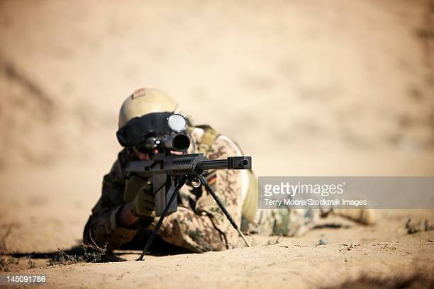 A German soldier sights in a Barrett M82A1 rifle on a range in Kunduz, Afghanistan.