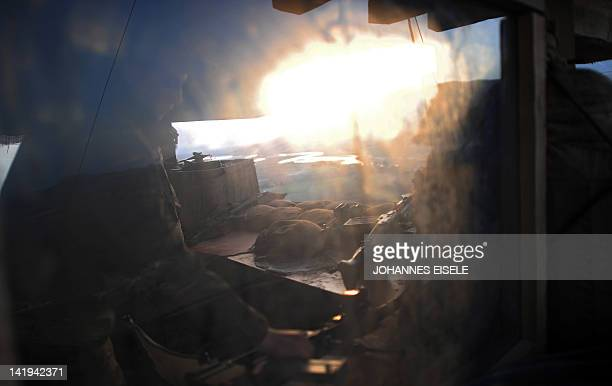 A German soldier sits in a tower during his guard shift in the outpost north near Baghlan on March 26 2012 Around 500 German soldiers are stationed...