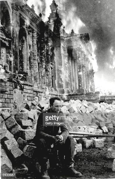 A German soldier sits on the ruins of the Reichstag on May 9 Berlin Germany in this photo taken by Russian photographer Mark Redkin On May 8 2000 the...