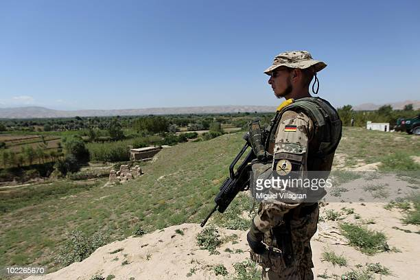 German soldier stands guard on a hill during a patrol close to an Afghan police checkpoint on June 10 2010 near Taloqan Afghanistan Germany has more...