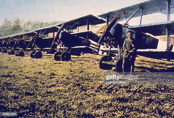 A German soldier stands near a row of Fokker DR1 triplanes on an airfield Germany 1910s The DR1 was designed by aircraft manufacturer Anthony Fokker...