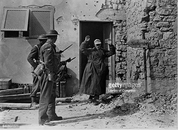 A German soldier surrenders to two South African soldiers in a village near Bardia Libya November 1942 | Location near Bardia Libya