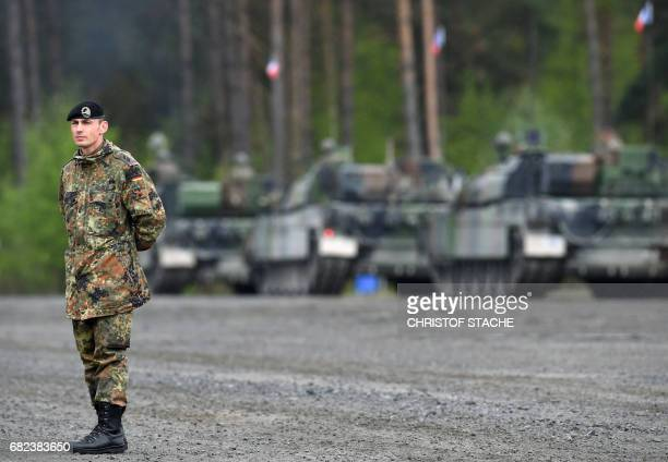 German soldier waits in front of French tanks type 'Leclerc' during the exercise 'Strong Europe Tank Challenge 2017' at a parking position at the...
