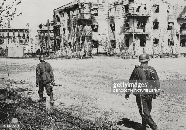 German soldiers among the destroyed buildings in Stalingrad Russia World War II from L'Illustrazione Italiana Year LXIX No 42 October 18 1942