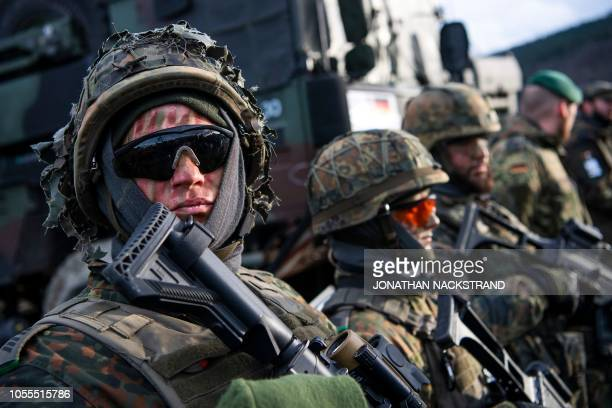 TOPSHOT German soldiers are pictured at a static display during the Trident Juncture 2018 a NATOled military exercise on October 30 2018 in Trondheim...