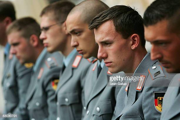 German soldiers attend celebrations marking the 50th anniversary of the founding of the Bundeswehr modern German armed forces at the Zeughaus on June...