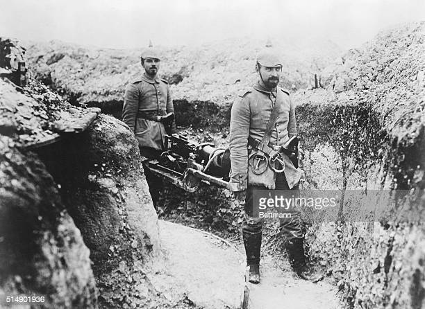 German soldiers carry a machine gun to a position in the advances trenches near Rheims, during World War I.