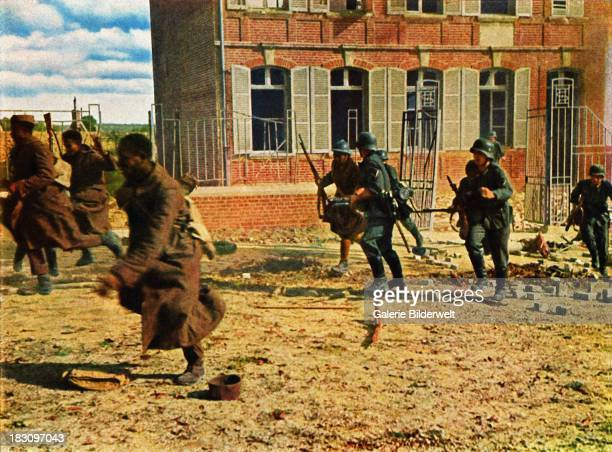 German soldiers chasing French soldiers of African origin during the Battle of France June 1940 The invasion started on 10th May 1940 and German...