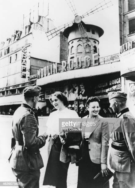 German soldiers chatting up French women outside the Moulin Rouge occupied Paris June 1940